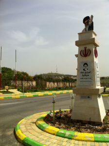 Traffic Circle in Kfar Kila, Lebanon, with Israel town Metula in background