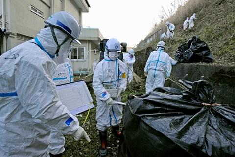 Workers decontaminate around an elementary school in the Katsurao town near the tsunami-crippled Fukushima Daiichi nuclear power plant in Fukushima