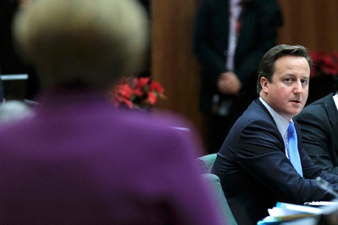 Britain's Prime Minister Cameron looks at Germany's Chancellor Merkel at a European Union summit in Brussels