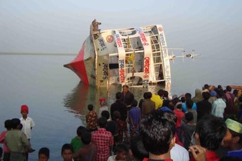 Bangladeshi villagers gather at the rive