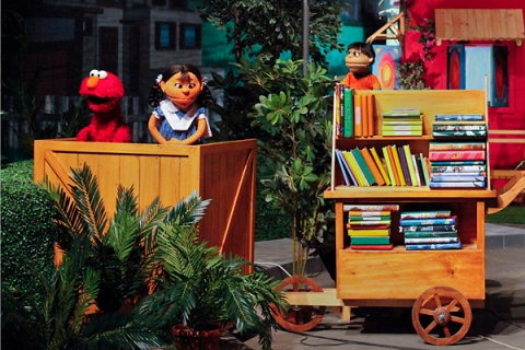 Sesame street characters with locally developed puppet characters perform at Rafi Peer Theatre Workshop in Lahore