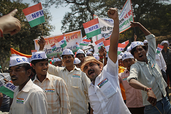 Workers from the National Federation of Indian Railwaymen (NFIR) shout slogans during a protest rally in Mumbai