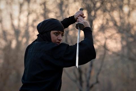 A Ninjutsu practitioner participates in a sword drill
