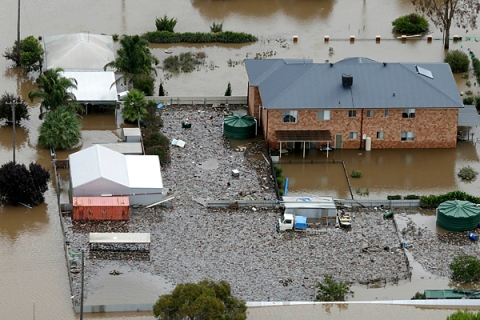 Floodwaters inundate a property in North Wagga