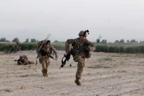 U.S. Army soldiers from 4-73 Cavalry Regiment, 82nd Airborne Division run for cover as they are fired upon by Taliban fighters during a mission in Zhary district of Kandahar province
