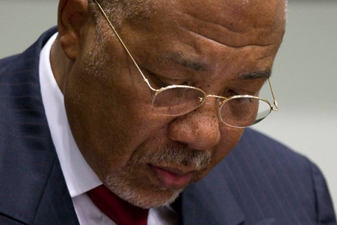 Former Liberian President Taylor looks down as he waits for the start of a hearing to receive a verdict in a court room of the Special Court for Sierra Leone in Leidschendam