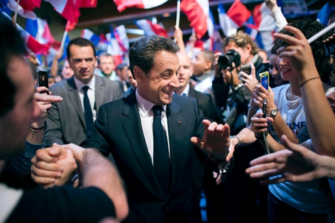 France's President and UMP party candidate for the French 2012 presidential election Sarkozy  shakes hands with supporters as he arrives at a campaign rally in Le Raincy