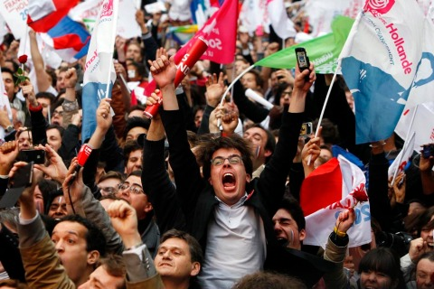 Supporters of Francois Hollande react after hearing election results outside the  Socialist Party campaign headquarters in Paris, France, on Sunday, May 6.