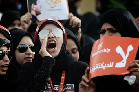 Bahraini protesters shout slogans as the