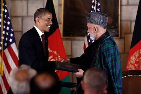 U.S. President Obama and Afghan President Karzai shake hands after signing the Strategic Partnership Agreement at the Presidential Palace in Kabul