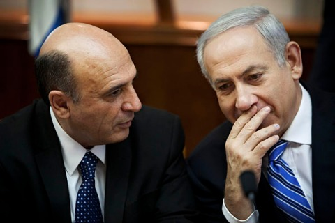 Israel's Prime Minister Netanyahu and newly appointed minister Mofaz attend the weekly cabinet meeting in Jerusalem