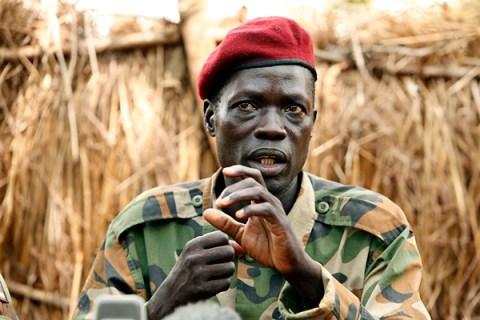 Lord's Resistance Army commander Caesar Achellam gestures as he speaks to the media in Djema