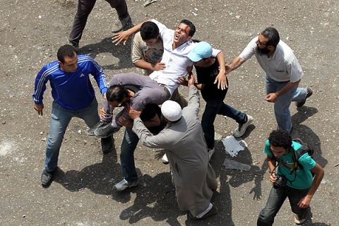 At least 20 were killed and more than 100 injured in Cairo amid clashes involving pro-democracy protesters irate at the ruling interim military government