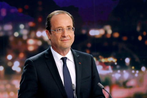 France's President Hollande is seen at the French Television France 2 studios ahead of his appearance on their prime time evening news programme in Paris