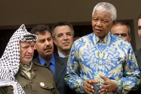 Former South African President Nelson Mandela (R)