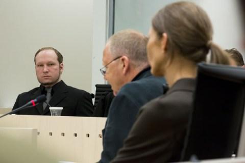 Anders Behring Breivik (C) looks on duri