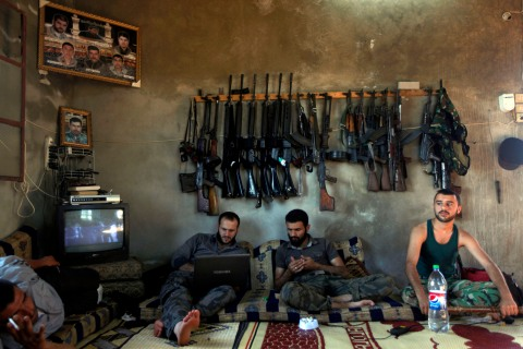 Free Syrian Army fighters sit in a house on the outskirts of Aleppo, Syria, Tuesday, June 12.