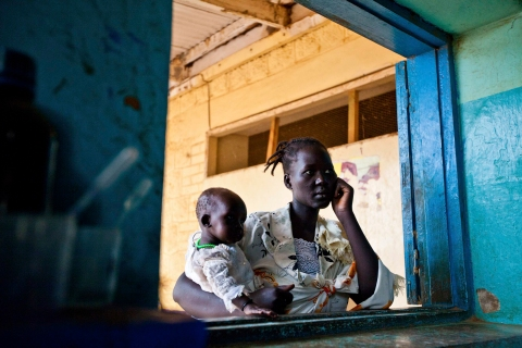 A woman and her child wait for test results at Aweil State Hospital in Aweil