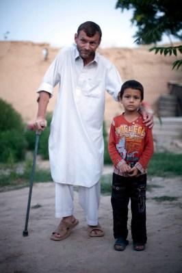 Image: Gennady Tseuma, with his son, Samiullah