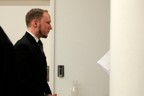Norwegian mass killer Breivik is escorted out of the the court room at the end of his trial in Oslo Courthouse