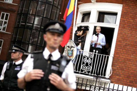 Assange addresses the media and supporters from Ecuadorian embassy