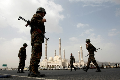 Yemeni soldiers stand guard outside the