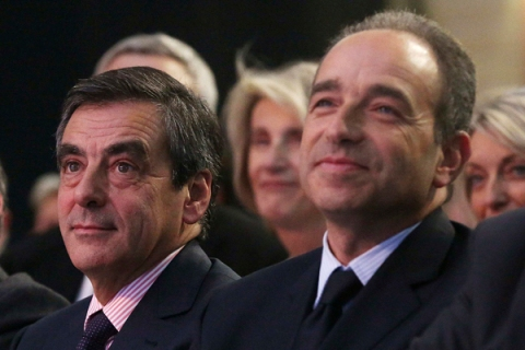 France's former prime minister Fillon and UMP political party head Cope attend a meeting during the UMP parliamentary day in Marcq en Baroeul
