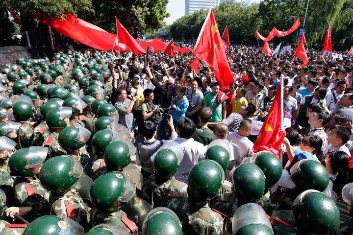 Riot police block demonstrators