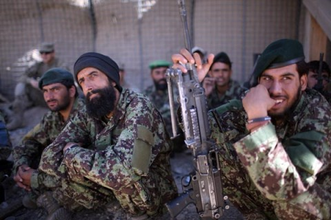 Afghan soldiers observe how to apply a tourniquet during drills at Combat Outpost Garda, Wardak Province.