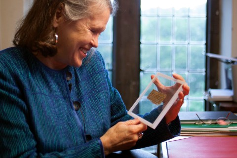 Handout photo of Karen L. King, the Hollis Professor of Divinity at Harvard University holding a previously unknown ancient papyrus fragment from Egypt