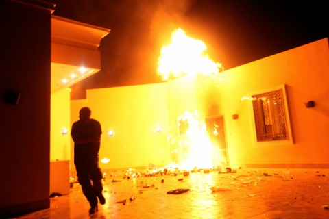 The U.S. Consulate in Benghazi is seen in flames during a protest