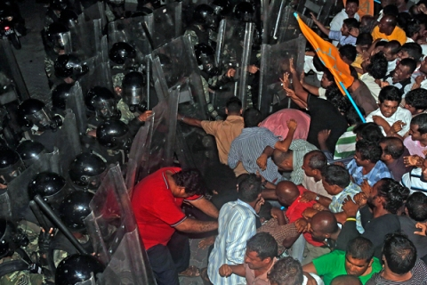 Supporters of former Maldivian president Mohamed Nasheed clash with soldiers during a protest in Male