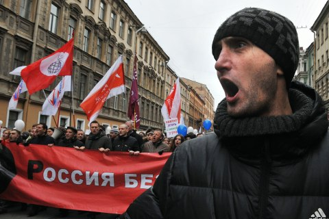 image: Members of Russia's opposition march in central Saint Petersburg, Feb. 25, 2012.