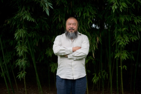 Chinese artist Ai Weiwei poses for a photo inside his compound in Beijing on June 25, 2012.