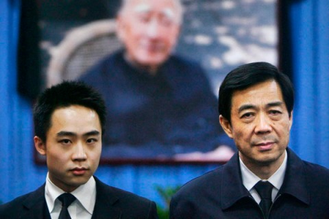 File photo shows Bo Xilai and his son Bo Guagua at a mourning hall in Beijing