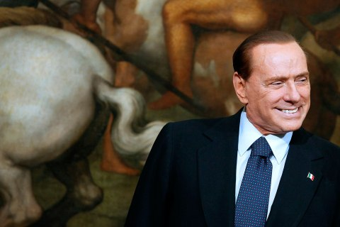 image: Silvio Berlusconi smiles after handing a small bell to Mario Monti during a ceremony at the Chigi palace in Rome, Italy, Nov. 16, 2011.