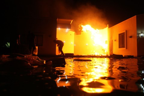 Image: The U.S. Consulate in Benghazi is seen in flames on the night of Sept. 11, 2012.