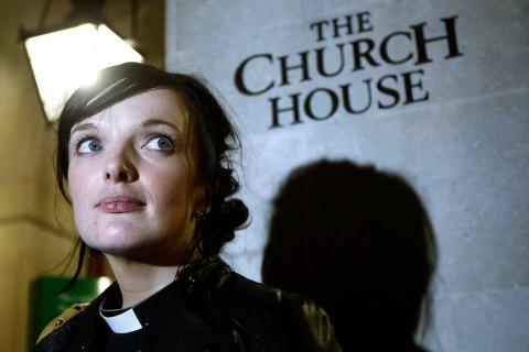Reverend Sally Hitchiner leaves after the vote for women bishops failed during the Synod at Church House in London