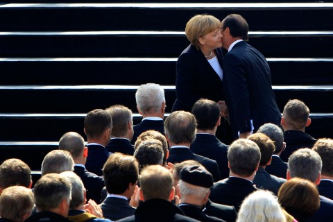 France's President Francois Hollande and Germany's Chancellor Angela Merkel kissing each other during anniversary ceremony in castle Ludwigsburg on Sept. 22, 2012.