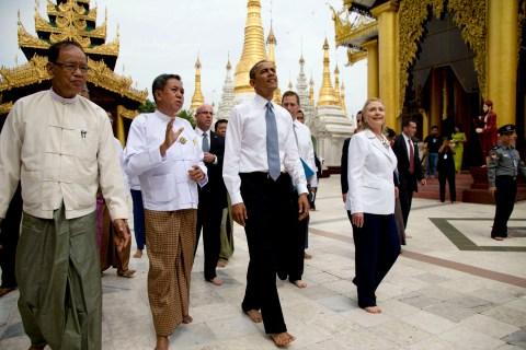 image: U.S. President Barack Obama tours the Shwedagon Pagoda with Secretary of State Hillary Rodham Clinton in Rangoon, Burma on Nov. 19, 2012.