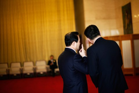Delegates chat outside of the Guangxi room before a meeting