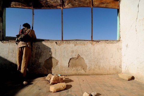 image: An ONLF soldier rests inside the destoyed town school during a sweep in the area for government soldiers in Ethiopia, Feb. 23, 2009.