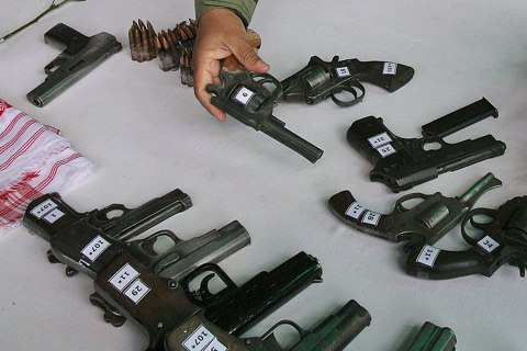 image: Indian army officials inspect arms, some handmade, surrendered by Separatist rebels in Indias northeast state Assam,, Jan. 24, 2008.