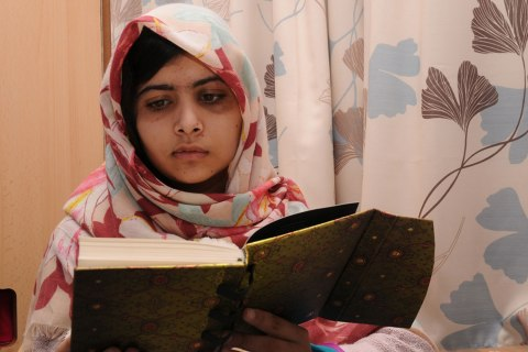 image: Malala Yousafzai reads a book in an undated handout photo released Nov. 9, 2012