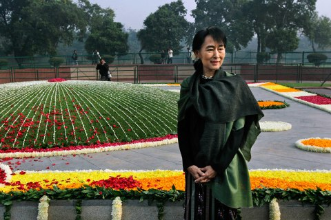 image: Burma's opposition leader and Nobel laureate Aung San Suu Kyi stands after paying floral tribute at the memorial of India's first Prime Minister Jawaharlal Nehru on his birth anniversary in New Delhi, India, Nov. 14, 2012.