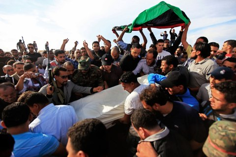 image: Police carry the body of Faraj al-Deirsy, head of Benghazi police, from the morgue after he was assassinated by unknown assailants in Benghazi, Nov. 21, 2012.