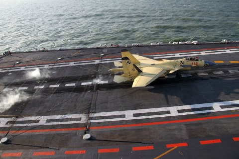 image: A J-15 fighter jet lands on China's first aircraft carrier, the Liaoning, Nov. 24, 2012.