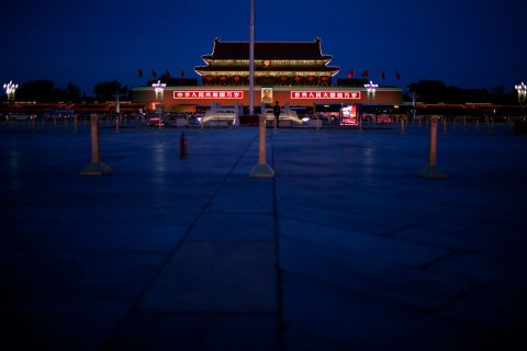 image: A paramilitary policeman guards the Chinese national flagpole before the 18th Chinese Communist Party National Congress, in Beijing, China, Nov. 7, 2012.