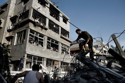 image: Palestinians sort through the rubble of a house hit by an Israeli air strike in Gaza City, Nov. 18, 2012.