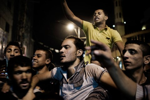 image: Palestinians celebrate a cease-fire agreement between Israel and Gaza in Gaza City, Nov. 21, 2012.